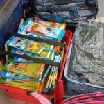 Stacks and stacks of books and backpacks