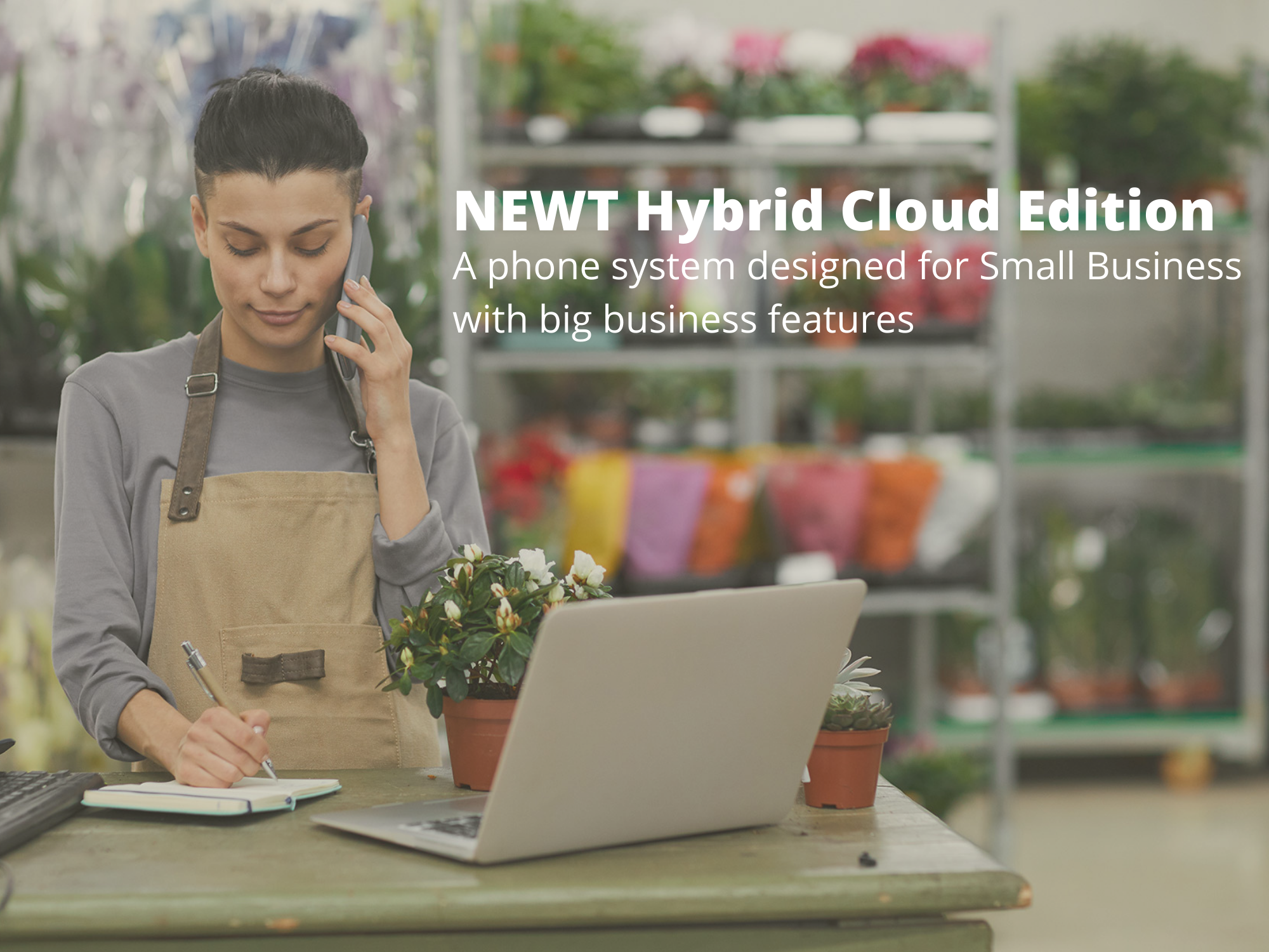 small business owner on phone with NEWT Hybrid Cloud Edition phone system